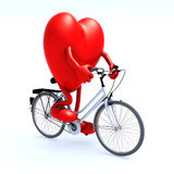 Heart riding a bicycle Royalty Free Stock Image