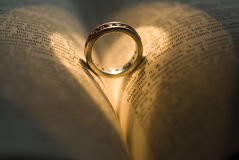 Heart ring. Heart shadow made in book Royalty Free Stock Photography