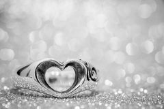 Heart ring on the floor with bokeh on background.  stock photos