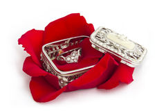 Heart Ring with Rose Petals. Heart Ring in Jewellery Box with Rose Petals stock photos
