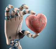 Heart Of a Robot. Robot hand holding a metal heart. Clipping path included Royalty Free Stock Images