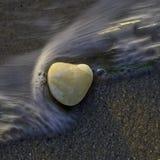 Heart Rock, The Sound, Cutchogue, New York. Heart Rock in wave, The Sound, Cutchogue, New York stock image
