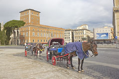 In the heart of Rome. View of Rome palazzo with horse carriage Royalty Free Stock Image