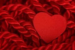 Heart On Rope. Red heart on red braided rope Royalty Free Stock Image