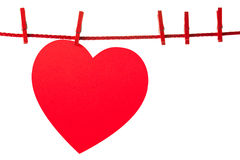 Heart on rope. Single heart hanging on rope. Valentine's concept. Isolated on white Stock Photo