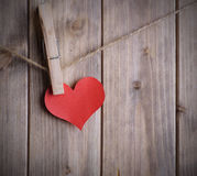 Heart on a rope with clothespin Royalty Free Stock Image