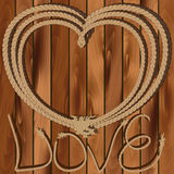 Heart of rope on a wooden background Stock Photos