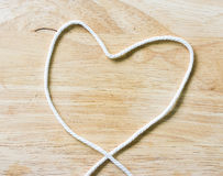 Heart Rope on a Wooden Stock Photo