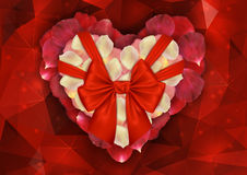 Heart of rose petals with bow Stock Image
