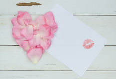Heart from rose petals, free space for your text with Lipstick kiss Royalty Free Stock Image