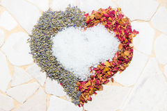 Heart of rose petals, lavender and bath crystals Stock Image