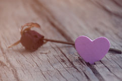 Heart and rose on wooden background Stock Photo