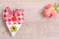 Heart and rose on a wooden board Stock Photos