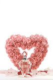 Heart of roses with crystal bottle Stock Photos