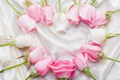 Heart from roses on satin Royalty Free Stock Photography