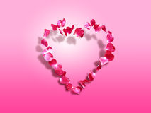 Heart of roses - St. Valentine's background. Rose petals in a heart shape - symbol of love and affection. Space for text royalty free stock photo