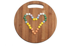 Heart of the round chocolate candies on a wooden board Stock Images