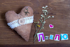 Heart with russian word LOVE on a wooden background Royalty Free Stock Images