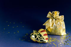 Heart and sack of presents Stock Photos
