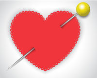 Heart and a safety pin Stock Photos