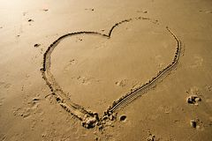 Heart on the sand. Heart on the beach sand Stock Images