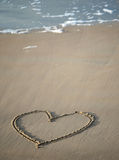 Heart on sand stock image