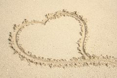 Heart in the sand 2. Heart drawn in the sand stock images