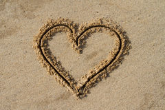 Heart in the sand. A heart shape drawen in the sand Stock Photos