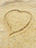 Heart on the sand. Drawing of the heart in the sand at the beach Royalty Free Stock Images