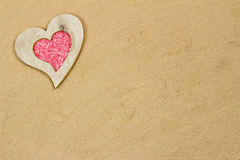 Heart in the sand. Handmade heart in the sand with copy space Stock Image