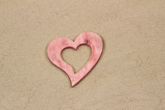 Heart in the sand. Handmade heart in the sand with copy space Stock Photo