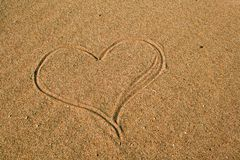 Heart in sand royalty free stock photos