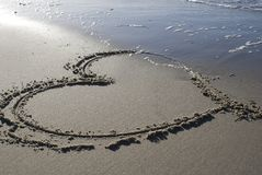 Heart in the sand. A big heart in the sand stock image