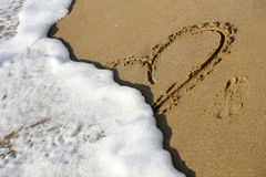 Heart on sand Stock Photography
