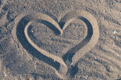 Heart in sand. Heart symbol drawn in sand Stock Photography