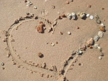 Heart on sand. Heart from stones on an ocean coast Stock Image