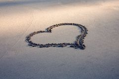 Heart shape drawn on beach Sand  Royalty Free Stock Images