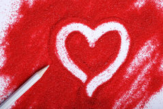 Heart on sand. Heart drawn on red sand Royalty Free Stock Photo