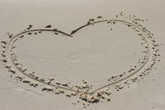 Heart in sand. Heart drawn in sand at beach Stock Photos