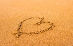 Heart on sand background stock image