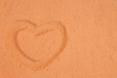Heart on the sand background Royalty Free Stock Images