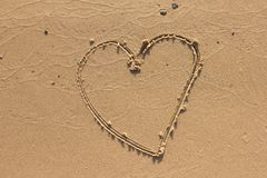 Heart on the sand beach.  Royalty Free Stock Image