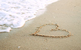 Heart in the sand on the beach Royalty Free Stock Images