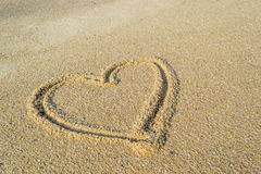 Heart on the sand beach backgrounds Stock Photo
