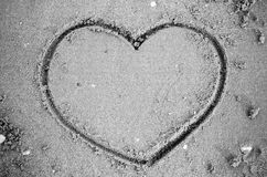 A heart on the sand in the beach black and white color tone styl Stock Photography