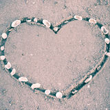 A heart on the sand in the beach Stock Photo
