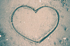 A heart on the sand in the beach Stock Photos