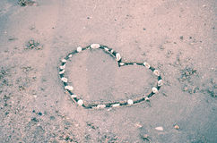 A heart on the sand in the beach Stock Image