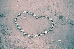 A heart on the sand in the beach Royalty Free Stock Images