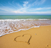 Heart on the sand of a beach. Royalty Free Stock Images